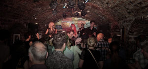 MonaLisa Twins at Cavern Club, Liverpool, band on stage with audience in front