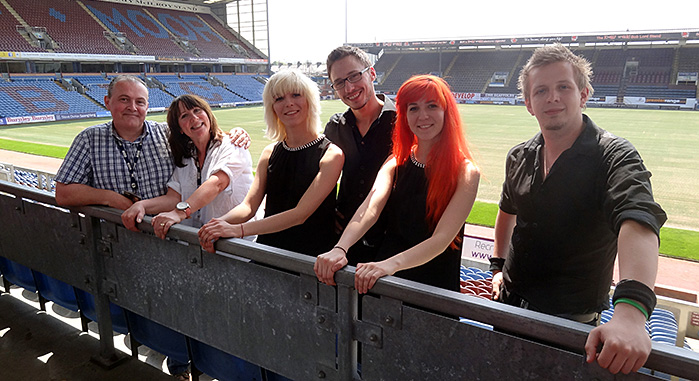 "MonaLisa Twins at Burnley Football Stadium, Lancashire, playing their original ""The Wide, Wide Land"" for Dementia Awareness Week 2014, aired on Sally Naden Show, BBC Radio Lancashire"