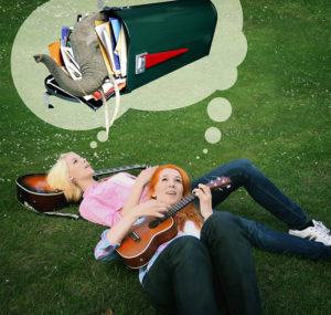 MonaLisa Twins lying in grass to announce New Fan Mail Address