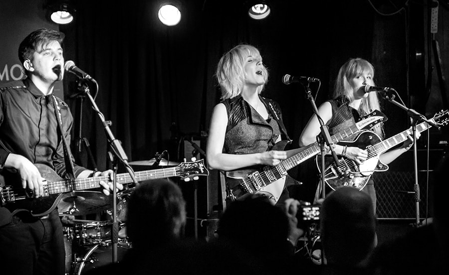 MonaLisa Twins playing a showcase concert at the Half Moon, Putney, London - black and white photo on stage