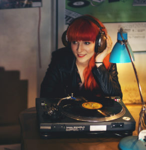 Lisa listening to Vinyl at Lizard Inc Records.