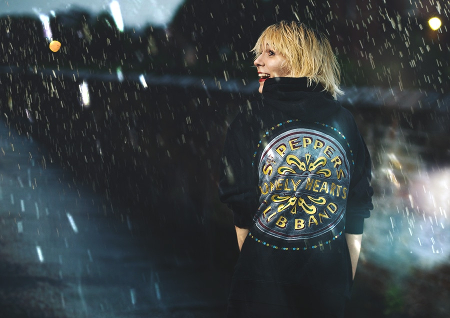 Mona in the rain with Sgt. Pepper Hoodie