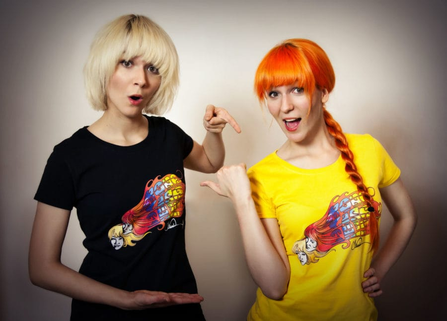 "MonaLisa Twins modeling their band T-shirts designed by ""Walking Dead"" illustrator Charlie Adlard"