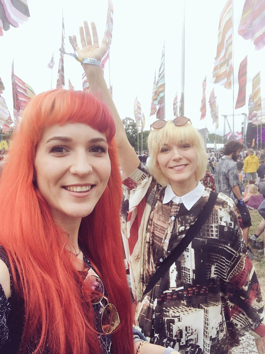 The MonaLisa Twins at Glastonbury festival strolling around before their show